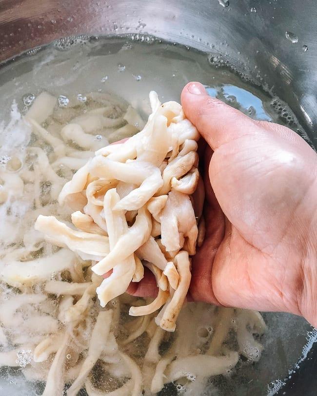 Washing the dried daikon pieces, thewoksoflife.com