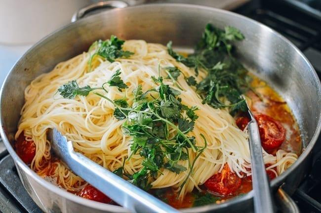 Tossing together slow roasted tomato pasta, thewoksoflife.com
