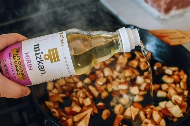 Adding Mizkan Mirin to mushrooms, thewoksoflife.com