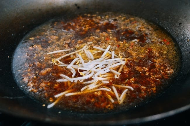 Adding bean sprouts to soup, thewoksoflife.com