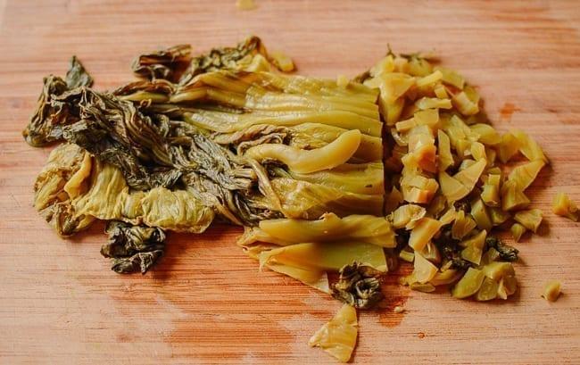 Chopping pickled mustard greens, thewoksoflife.com