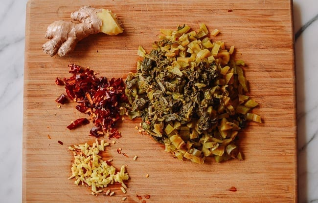 Pickled mustard green with ginger and dried chili, thewoksoflife.com