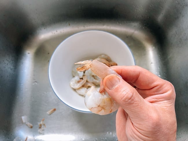 Peeled shrimp with tail meat still intact, thewoksoflife.com