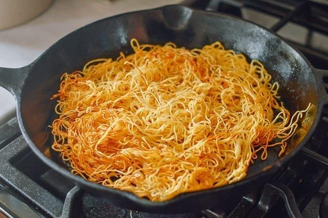 Flipping pan-fried noodles, thewoksoflife.com
