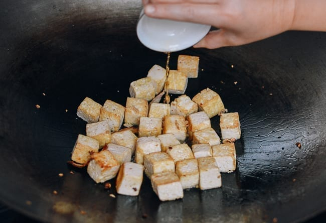 Adding Shaoxing wine to tofu, thewoksoflife.com
