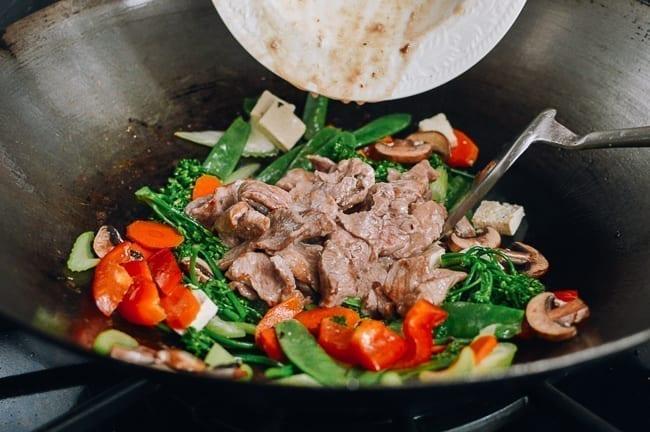 Adding pork back to wok, thewoksoflife.com