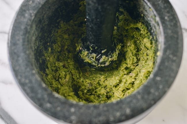 Pounded aromatics in mortar and pestle, thewoksoflife.com