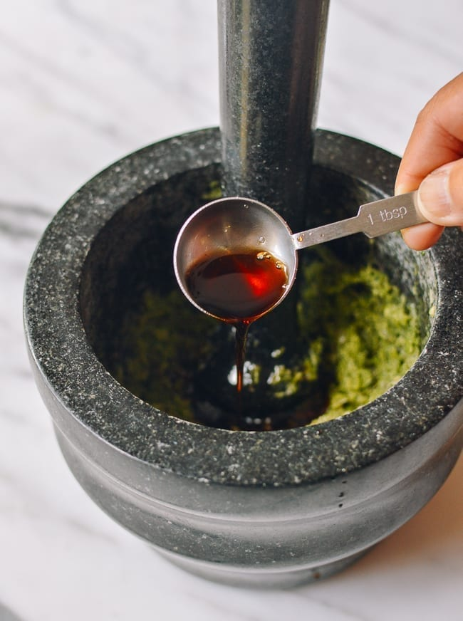 Adding other marinade ingredients to mortar and pestle, thewoksoflife.com