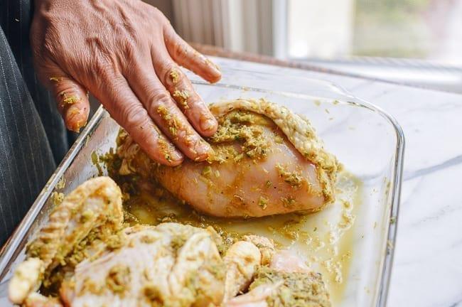 Rubbing marinade into chicken pieces, thewoksoflife.com
