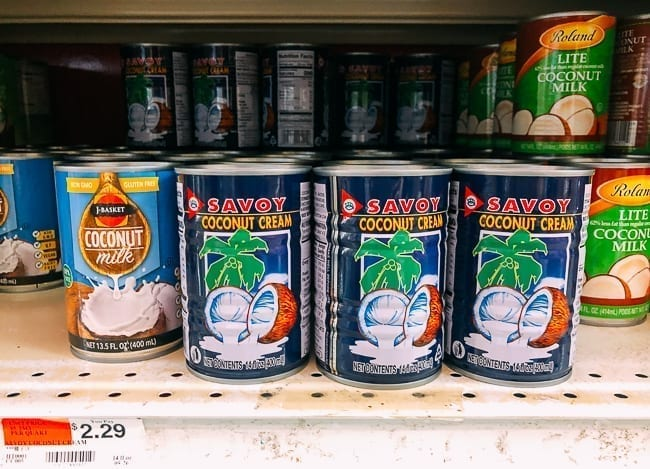 Cans of coconut cream on store shelves, thewoksoflife.com