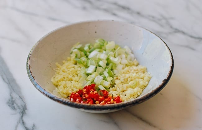 Bowl with ginger, garlic, scallions, thai chili, thewoksoflife.com