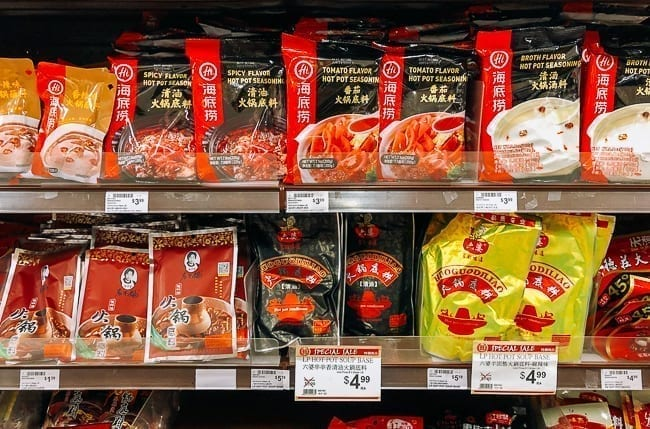 Different varieties of hot pot soup base on store shelves, thewoksoflife.com