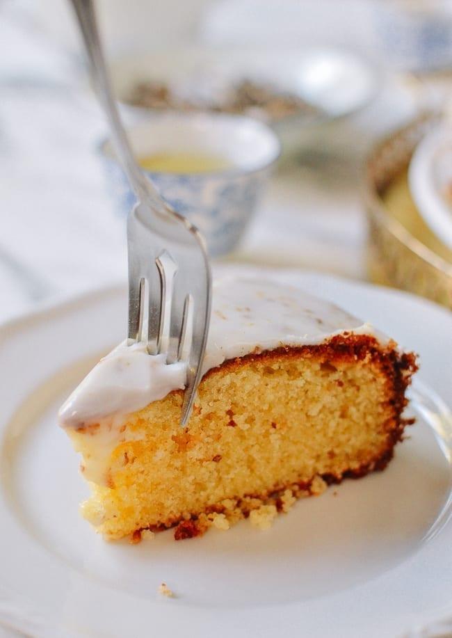 Fork cutting through osmanthus cake slice, thewoksoflife.com