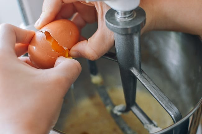 Adding eggs to creamed butter, sugar, and oil, thewoksoflife.com