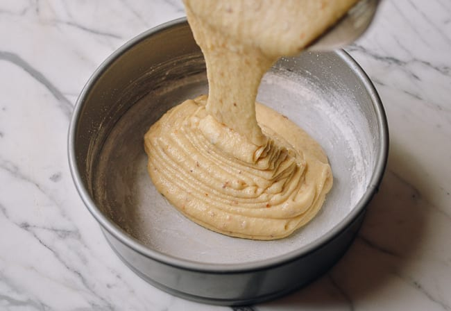 Pouring cake batter into greased and floured springform pan, thewoksoflife.com