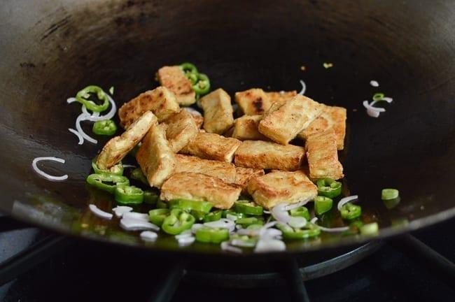 Adding tofu back to wok, thewoksoflife.com