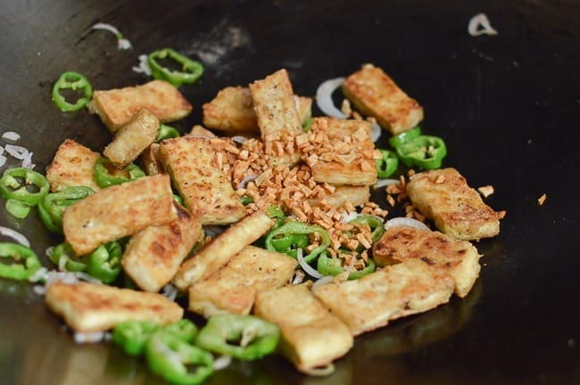 Adding fried garlic back to wok, thewoksoflife.com