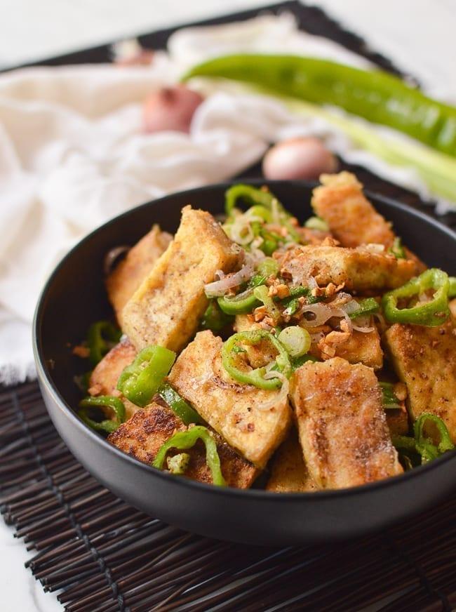 Salt and pepper tofu in black bowl, thewoksoflife.com