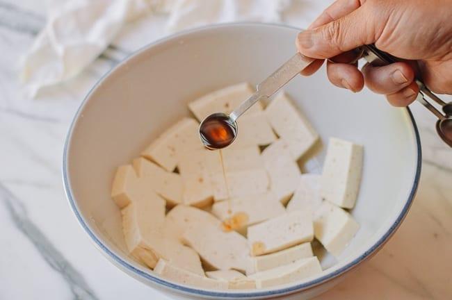 Adding sesame oil tofu, thewoksoflife.com
