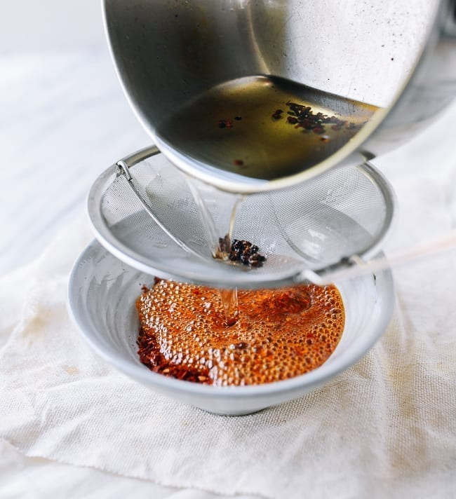 Pouring hot oil over chili flakes, thewoksoflife.com