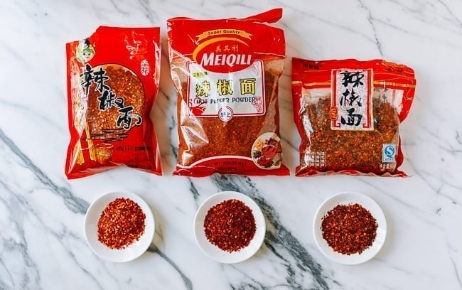 Different brands of Chinese Sichuan chili flakes, thewoksoflife.com