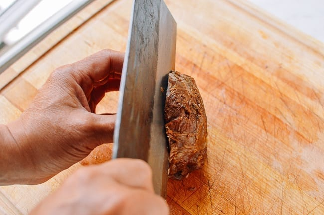Slicing beef shank in half lengthwise, thewoksoflife.com