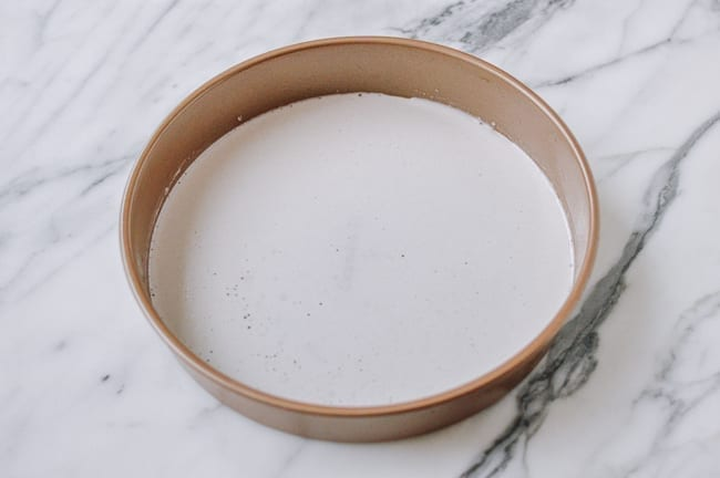 Thin layer of batter in cake pan, thewoksoflife.com