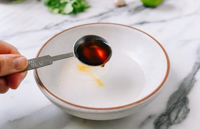 Adding fish sauce, thewoksoflife.com