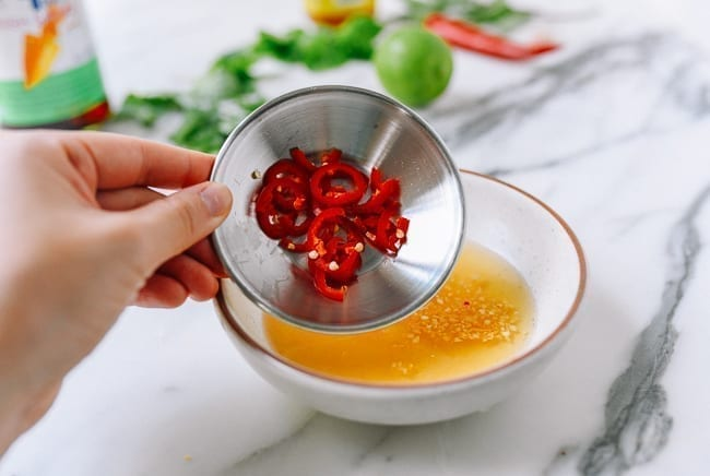 Adding chilies, thewoksoflife.com