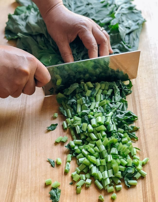 Chopping kale greens, thewoksoflife.com