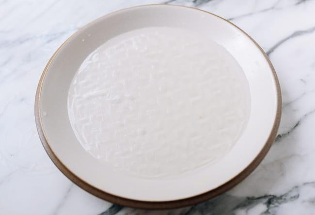 Soaking rice paper in sugar water, thewoksoflife.com