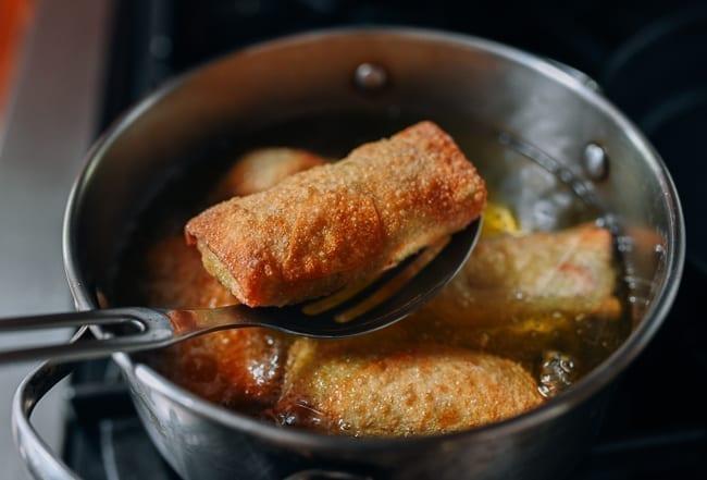 Frying egg rolls, thewoksoflife.com