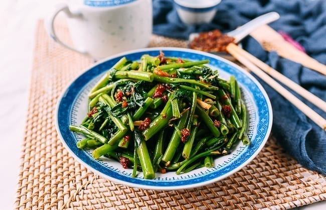 Kangkung belacan in blue and white bowl