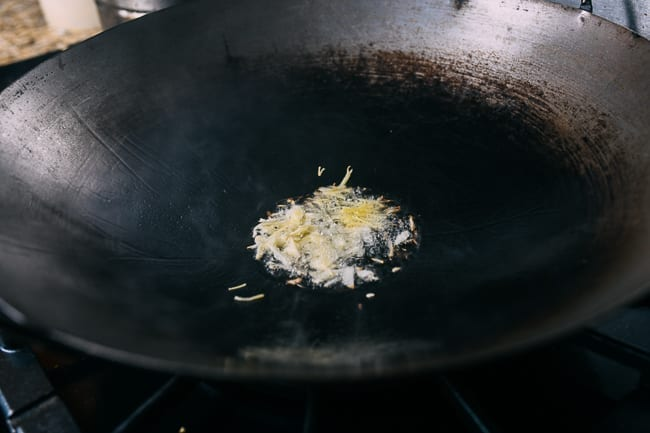 Oil, ginger, and garlic in wok
