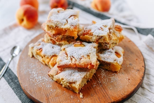 Pile of peach squares dusted with powdered sugar, thewoksoflife.com