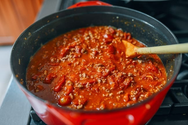 Stirring pot of tomato meat sauce, thewoksoflife.com