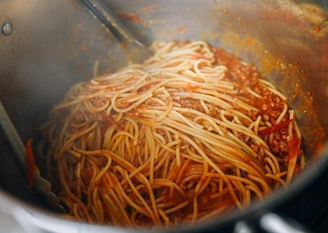 Tossing pasta in sauce, thewoksoflife.com