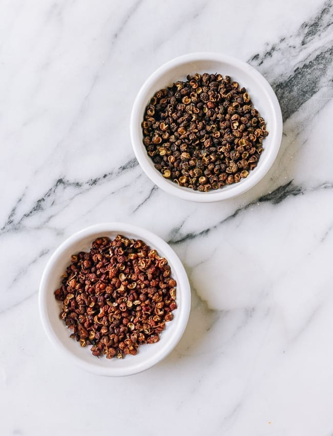 Red and Green Sichuan Peppercorns in small dishes, thewoksoflife.com