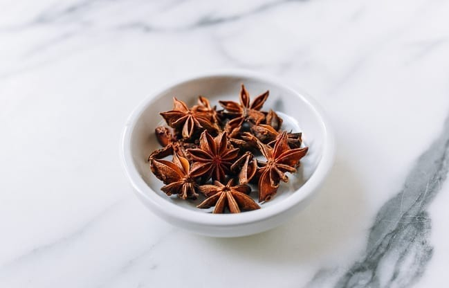 Star Anise pods in small white dish