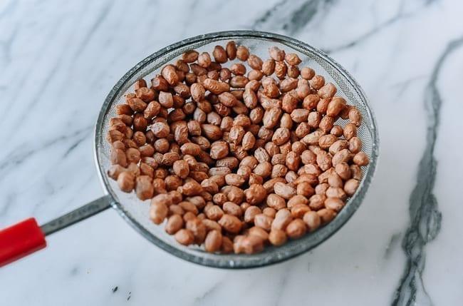 Peanuts in strainer, thewoksoflife.com