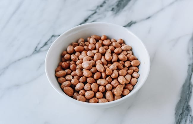 Bowl of peanuts with skin still on, thewoksoflife.com