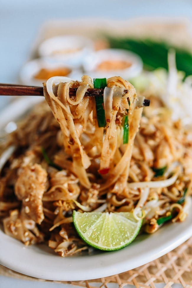 Lifting pad thai with chopsticks, thewoksoflife.com