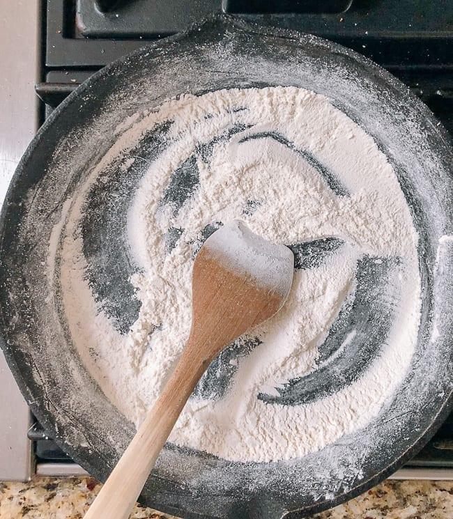 Toasting glutinous rice flour in dry pan, thewoksoflife.com
