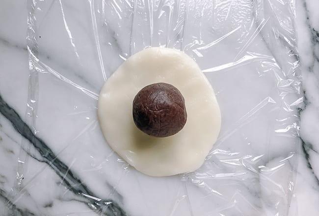 Ball of filling on disc of mochi dough, thewoksoflife.com