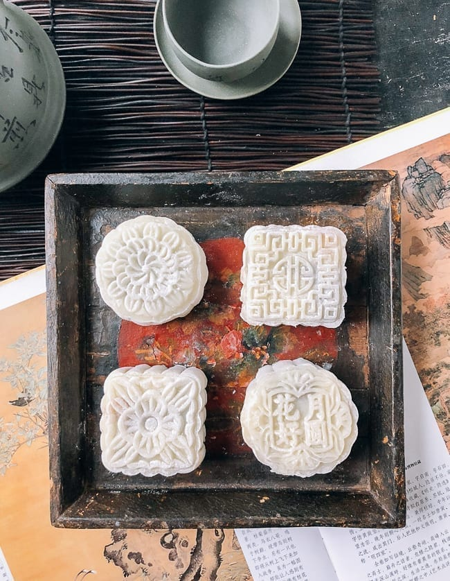 Four snow skin mooncakes on square wooden dish, thewoksoflife.com
