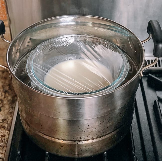 Covered bowl of mooncake dough in steamer, thewoksoflife.com