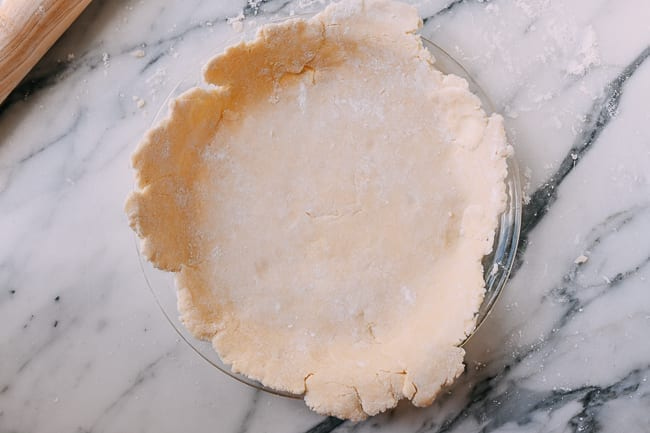 Pie crust in pie plate, thewoksoflife.com