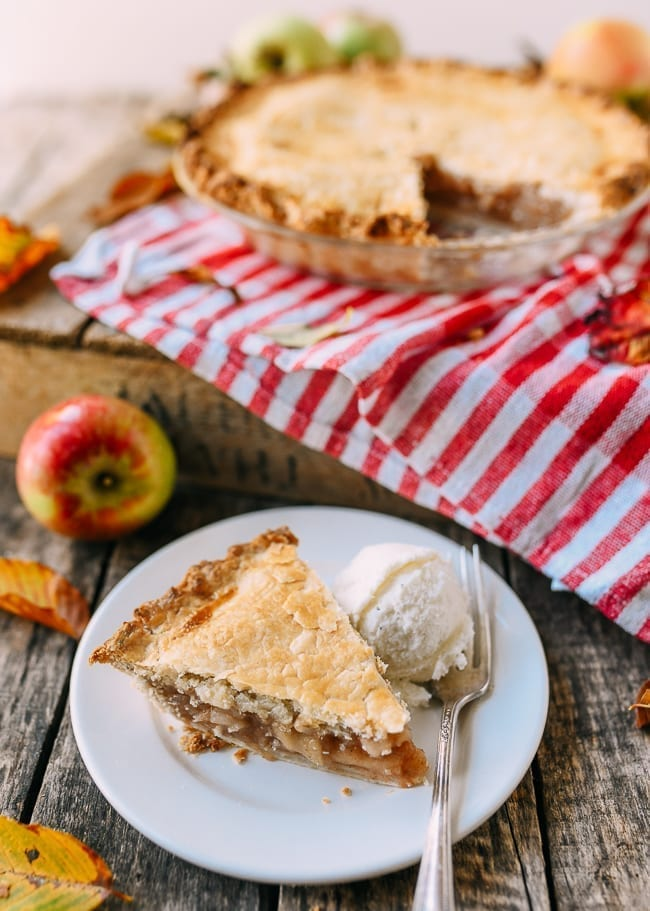 Slice of flaky apple pie with ice cream, thewoksoflife.com
