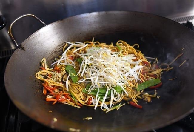 Adding bean sprouts to lo mein, thewoksoflife.com