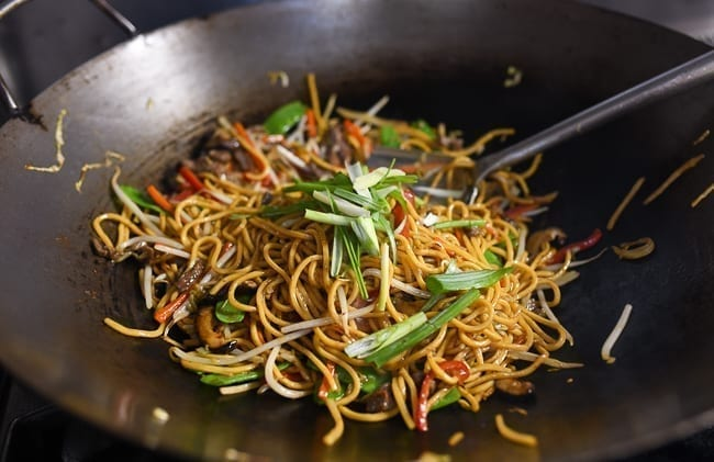 Adding green parts of scallions to lo mein, thewoksoflife.com